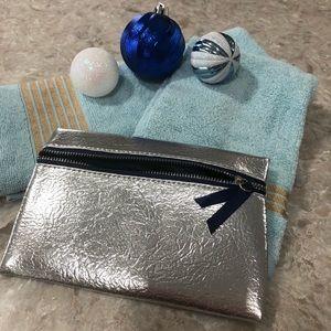 Silver medium size make up case with blue zipper